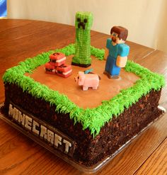 "Minecraft cake! - Nathan's Minecraft cake! 2 layer 10 in square cake, all buttercream and candy clay accents, with crushed oreos, chocolate cookies and cocoa powder ""dirt"" on the side! All edible and no fondant!"