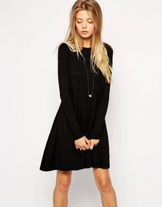 Buy it now. ASOS Swing Dress with Long Sleeves and Seam Detail - Black. Dress by ASOS Collection, Stretch jersey, Crew neckline, Exposed seams, Button keyhole back, Swing shape, Relaxed fit, Machine wash, 97% Viscose, 3% Elastane, Our model wears a UK 8/EU 36/US 4 and is 174cm/5'8.5 tall. ABOUT ASOS COLLECTION Directional, exciting and diverse, the ASOS Collection makes and breaks the fashion rules. Scouring the globe for inspiration, our London based Design Team is inspired by fashion�s…