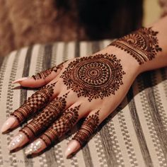 Bridal Mehndi Design 2020 - - The color and fragrance of your Mehendi will add more love to your life's rainbow. Here are some top mehendi theme ideas for your wedding day. Henna Hand Designs, Circle Mehndi Designs, Round Mehndi Design, Henna Tattoo Designs Simple, Indian Mehndi Designs, Modern Mehndi Designs, Mehndi Designs For Girls, Mehndi Design Photos, Wedding Mehndi Designs