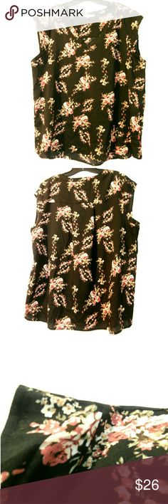 """Daniel Rainn XL Black & Floral Sleeveless Top This Daniel Rainn XL Black & Floral Sleeveless Top is in great used condition. This beautiful top is easy care 100% polyester with just a tiny bit of stretch to it. Bust measures 25"""" across laying flat, measured from pit to pit, so 50"""" around. 28.5"""" long. ::: Bundle 3+ items from my closet and save 30% off when you use the app's Bundle feature! ::: No trades. Daniel Rainn Tops"""
