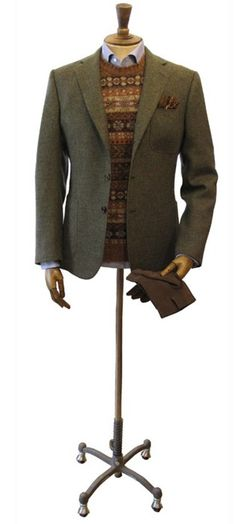 Nice Ivy look by Drake's from London. Tweeds and fairisle in countryside colors on top of a decent light blue shirt.