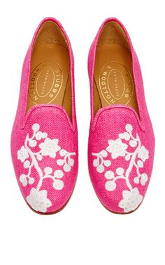 This slipper by **Stubbs & Wootton** is rendered in fuchsia linen and features an embroidered toe and wooden stack heel.