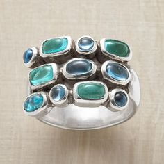 COOL COBBLESTONES RING -- Blue-green apatite and blue topaz stones pave the top of our sterling band, designed exclusively for Sundance. Imported. Whole sizes 5 to 9.
