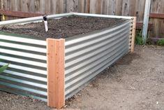 Attaching irrigation valves for each raised metal garden bed Metal Raised Garden Beds, Raised Planter Beds, Wooden Garden Planters, Building A Raised Garden, Raised Beds, Hillside Garden, Home Vegetable Garden, Corrugated Metal, Garden Boxes