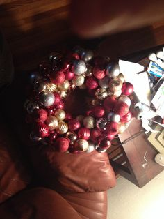Christmas Ornament DIY Wreath, $3 Hobby Lobby straw wreath covered with shatterproof bulbs attached by using a hot glue gun! Festive easy and fun!!!