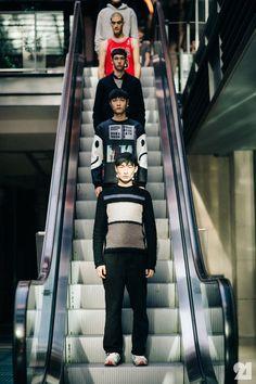 Male models on the escalator
