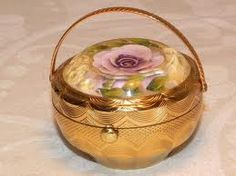 1950's Kigu lucite flower topped flower basket compact.
