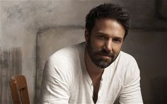 Ben Affleck, in his Argo. Salt n pepper with beard. Shaggy and buff. Total hunk!