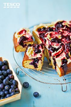 This cake recipe is a surefire picnic basket treat: holes are poked into a springy almond and thyme sponge, before being filled with a heavenly blueberry and lemon compote. | Tesco