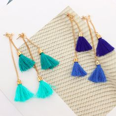 - Tassels are a fun way to add vibrant color to your outfit. It's a statement making trend of this season! - Gold tone earrings - Modular style with fringed tassel accents - Wear our Double Tassel Earrings 4 ways: 1. Both tassels in the front 2. One tassel in front and the other one in the back 3. One tassel only 4. Pair one of your stud earrings and add the longer tassel in back