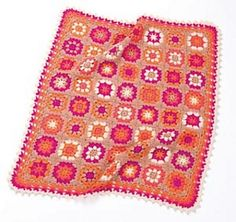 Colorful granny squares are combined along with a 5-row border edging of clusters and picot. (Lion Brand Yarn)