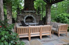 Image result for stone and teak fence