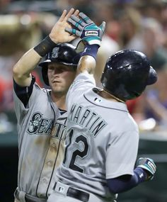 Shawn O'Malley #36 of the Seattle Mariners and Leonys Martin #12 celebrate scoring against the Texas Rangers in the seventh inning at Globe Life Park in Arlington on August 29, 2016 in Arlington, Texas.