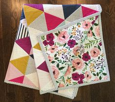 Our quilts are a great addition to any new nursery! Both front and back are 100% KONA cotton with a center of cotton batting.Measuring at approximatly 35 x 40 Inches this modern straight lin whole cloth quilt is not only great for snuggling. Its large enough to throw on the ground