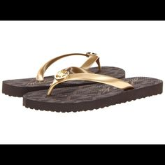 Micheal lots flip flops. Made for skinny feet NWOT Gold and brown however my feet are too wide for these Michael Kors Shoes Sandals