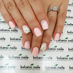 Beautiful and simple pink nail art design. Using white and light pink as base color, soft pink colors with leaves re painted on top. Silver beds are also added for accent.