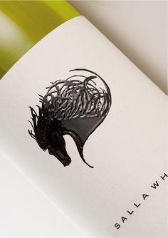 Love the liquid look of this wine label design: created by overprinting the black ink with a second horse image in tactile varnish.