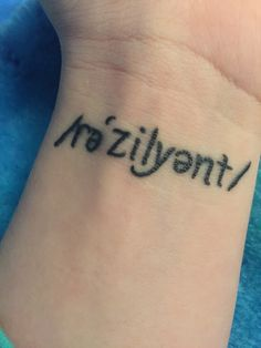 This tattoo represents my battle with mental illness. No matter what I go through I am resilient, I will fight my way through every hardship and I will win. I chose to uniquely represent the word resilient in diacritical form.