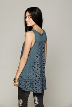 Super soft tank top with pretty eyelet back and trimming around the bottom sides. Crochet detailing at front of chest with corset-style ties. Hi-low hem. Super easy swing shape. $29.95 by Free People