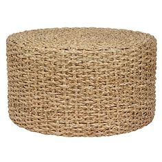 A hand-knotted rush grass ottoman is versatile and ideal for a beach house. | $128