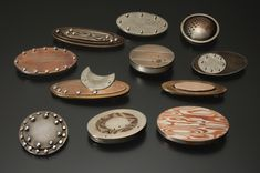 """these brooches are part of a large series, and show mokume gane, or patterned metals techniques. they range in size from about 3/4"""" wide to 1.5"""" wide."""