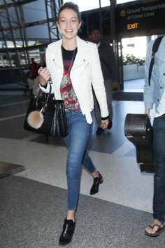 Who: Gigi Hadid What: Ankle Booties Why: The model showcases perfect off duty airport style in skinny jeans and boots that hit directly at the ankle with a small heel. Get the look now: Alexander Wang boots, $495, alexanderwang.com.   - HarpersBAZAAR.com