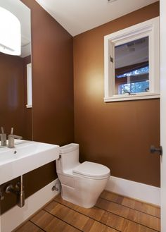 Brown Painted Bathroom With White Trim And Amenities