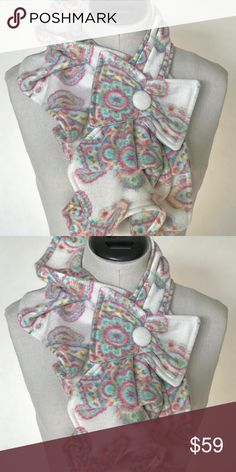 Print Fleece Ruffle Scarf with Bow Detail Stunning and unique fleece ruffle scarf with bow. Put this scarf around your neck and simply put the button thru the loop.  The design is beautiful with a coat, denim jacket or a blouse. Accessories Scarves & Wraps