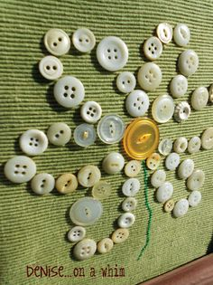 I would do this on linen and put in am old frame, or make a pillow.  From denise...on a whim: A Button Daisy