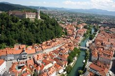 Ljubljana's Old Town and Castle (Ljubljana, Slovenia) p. Places To Travel, Places To See, Bohinj, Air Photo, Backpacking Europe, By Train, Beautiful Buildings, Lonely Planet, Aerial View