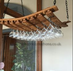 Suspended wine glass rack, made to order.