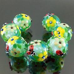 PIKALDA=handmade lampwork 7 glass beads ladybug flower blossom=GREEN DAY=SRA