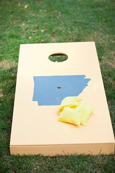 awesome state cornhole boards! @Jenn Green - this doesnt really fit the decor, but theyd be awesome for the backyard! hmm maybe ill be crafy and itll be a wedding present! LOL