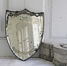 Vintage shield mirror