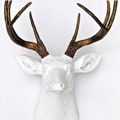"""Tasteful Taxidermy """"The key to keeping taxidermy tasteful is moderation,"""" GQ says. """"No modern man's home should have a wall-mounted zoo."""" Limit your look-alike pieces to mounted horns or antlers or even faux busts for a dose of wilderness appeal without a full-on hunting lodge aesthetic. White and Bronze Faux Deer Head, $90, OpenSky"""