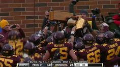 a) Why do Minnesota and Penn State play for a trophy? b) Why is it so structurally poor?