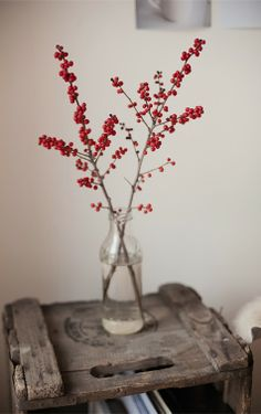 Berried branches in vases and jars add color to small spaces