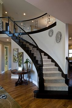 Modern Stair Railing Designs That Are Perfect! Looking for Staircase Design Inspiration? Check out our photo gallery of Modern Stair Railing Ideas.Looking for Staircase Design Inspiration? Check out our photo gallery of Modern Stair Railing Ideas. Black Stair Railing, Black Stairs, Staircase Railings, Curved Staircase, Staircase Design, Stairways, Stair Case Railing Ideas, Winding Staircase, Metal Railings