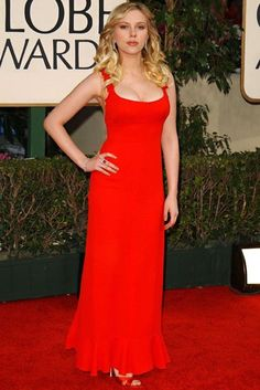 65 Best Golden Globe dresses of all time -   SCARLETT JOHANSSON -   A typical look from our perennial blonde bombshell, Scarlett Johansson certainly knows how to get heads turning when she wants to. The actress teamed her bold red dress with co-ordinating shoes, Hollywood curls and a sultry pose. The ultimate Scarlett woman (excuse the pun). (2006)