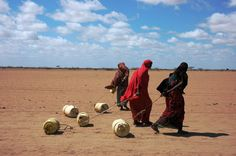 Women in Kenya drag jerry cans of water 4 kilometers through a parched landscape. Photo by Erin Gray/Mercy Corps. Erin Gray, Student Photo, Jerry Can, Kenya, Hand Washing, Water, Strong, Landscape, Photos