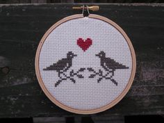 Love birds in a hoop.