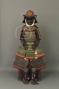 '17th Century 'Moegi Odoshi Nimai-Dou Gusoku' (Green Laced Armour)'. This all matching Iwai school armour bears the heraldry of the Ishikawa clan, based in the former fiefdom of Ishikawa (part of present day Osaka). It appears to have been made for a young man or adult of small stature, but of considerable financial means. -Robert Winter Japanese Art, Kyoto-