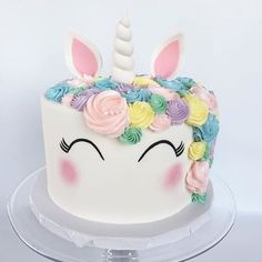 We finally stopped squealing over how cute this unicorn cake was long enough to take a picture!  #cocoaandfig #unicorncake #birthdaycake