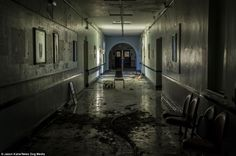 Remains: A corridor in the abandoned infirmary is littered with old hospital equipment. The sprawling building now lies empty with hospital ...