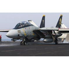 An F-14D Tomcat launches off the flight deck of USS Theodore Roosevelt Canvas Art - Gert KromhoutStocktrek Images (36 x 23)