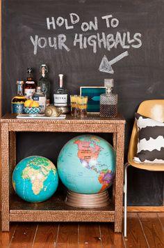 Snakeskin bar + vintage globes + chalkboard wall