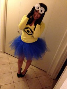 DIY Minion costume. Made tutu with tile, drew on G with sharpie to yellow shirt & made goggles with headband & styrofoam cup top part cut & felt eyes glued on :) fun