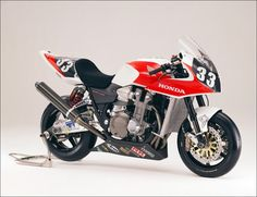 CB 1300 racing.  The symphony of Internal Combustion inside that aesthetically pleasing engine... play it again Sam.