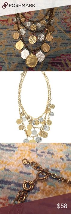 Cabi coin necklace. Silver and gold toned. Statement piece! Cabi coin necklace. You can wear it two ways—with the coins showing or the flat side. See picts. CAbi Jewelry Necklaces