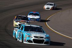 Danica Patrick Photos Photos - Danica Patrick, driver of the #10 Nature's Bakery Chevrolet, leads a pack of cars during the NASCAR Sprint Cup Series Can-Am 500 at Phoenix International Raceway on November 13, 2016 in Avondale, Arizona. - NASCAR Sprint Cup Series Can-Am 500